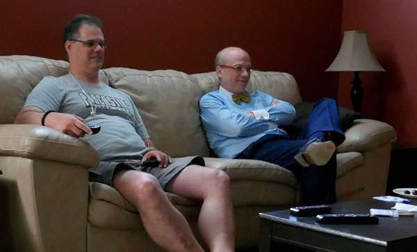 Mark and Fred watching Killjoys in Mark's basement.